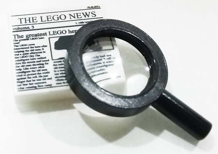 magnifying glass with lego news
